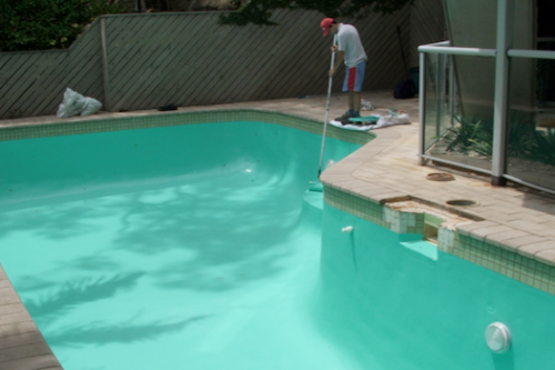 cap 3 - this pool is being Epoxy Resin coated with Aqua Mist