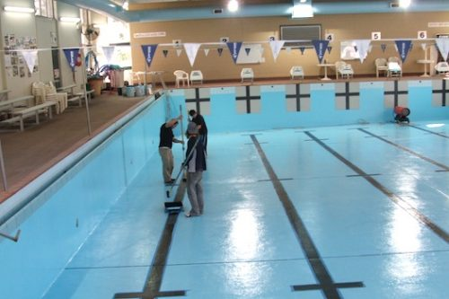6c commercial pool - Galston, Hornsby council, NSW - pool painted; new black lane lines painting in progress
